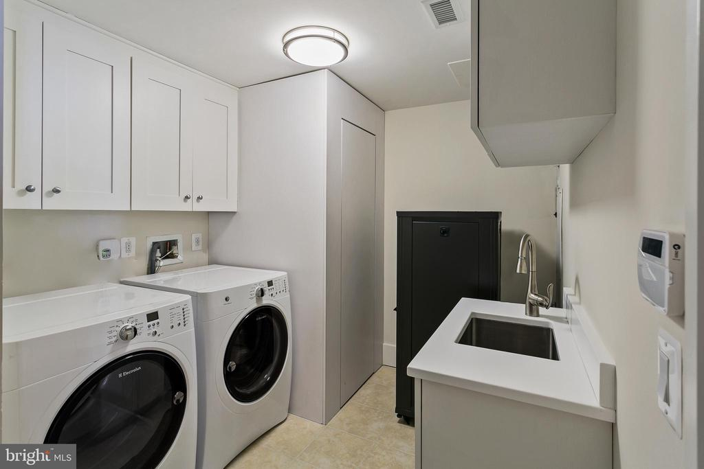 Laundry room with storage - 601 N FAIRFAX ST #211, ALEXANDRIA