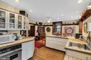 Gas cooktop, wall oven, newer refrigerator - 13410 GOODHART LN, LEESBURG