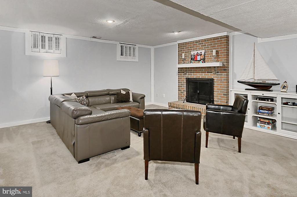 Lower level rec room with cozy fireplace! - 10625 TIMBERIDGE RD, FAIRFAX STATION