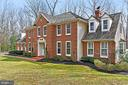 Brick front with beautiful landscaping. - 10625 TIMBERIDGE RD, FAIRFAX STATION