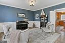 Living room with gorgeous wainscoting. - 10625 TIMBERIDGE RD, FAIRFAX STATION
