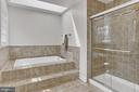 Master bath with relaxing tub and separate shower. - 10625 TIMBERIDGE RD, FAIRFAX STATION