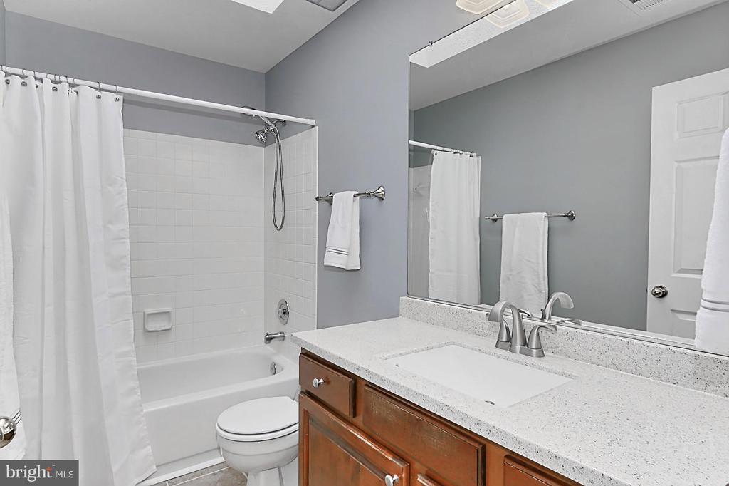 Updated hall bath. - 10625 TIMBERIDGE RD, FAIRFAX STATION