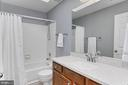 Updated hall bath. - 10625 TIMBERIDGE RD, FAIRFAX STATION