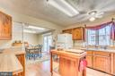 Warm hued & plenty of Cabinets & counter tops - 200 HAPPY CREEK RD, LOCUST GROVE