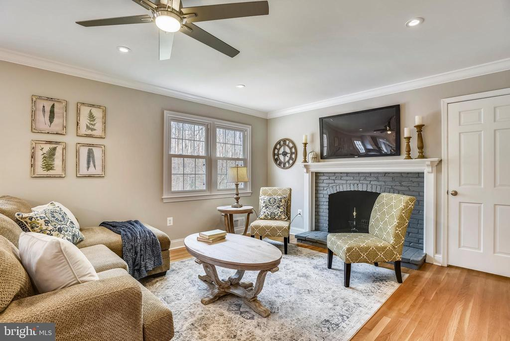 Family room with fireplace - 8324 OLD DOMINION DR, MCLEAN