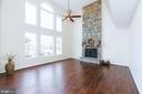 2-story great room, raised hearth stone FP - 25948 DONOVAN DR, CHANTILLY