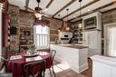 Timeless kitchen design with copper range hood. - 2010 FALL HILL AVE, FREDERICKSBURG