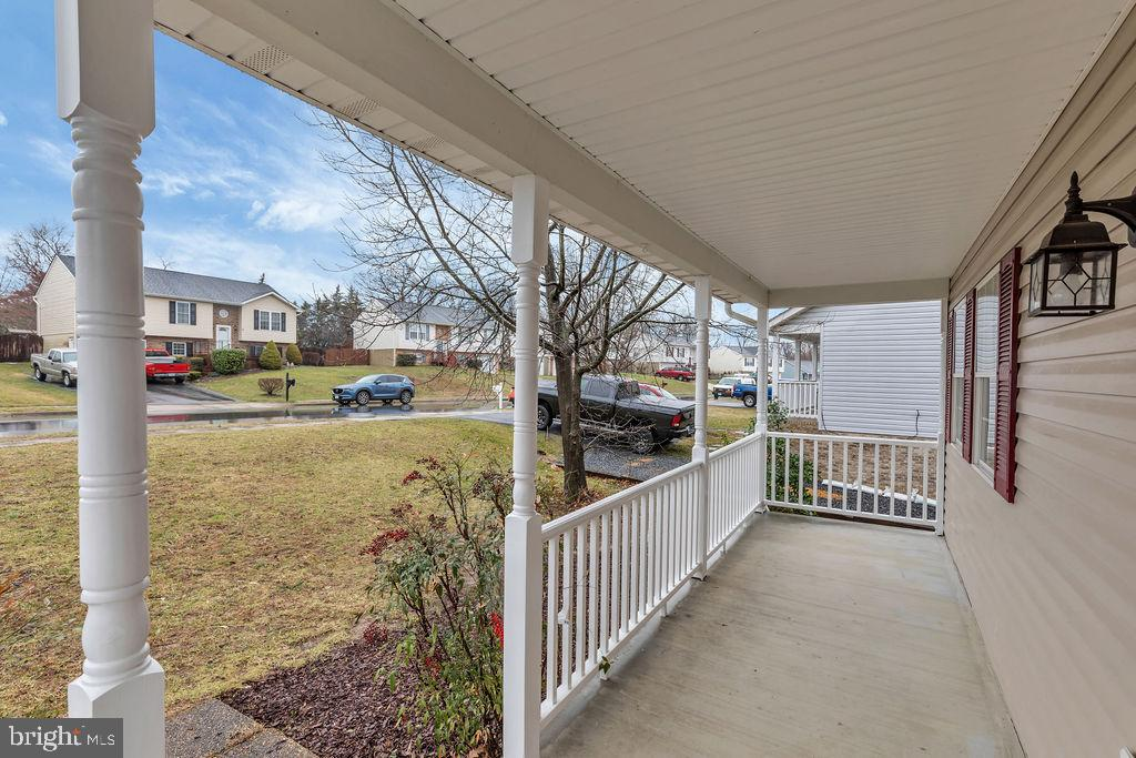 Cozy front porch with new  vinyl railings - 129 HILL VALLEY DR, WINCHESTER