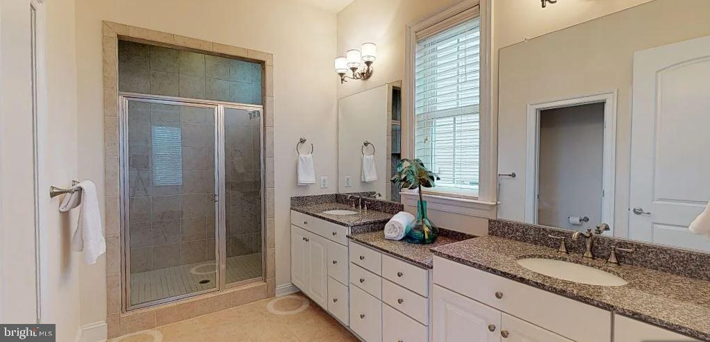 Expanded master bathroom with dual showerheads - 25532 EMERSON OAKS DR, ALDIE