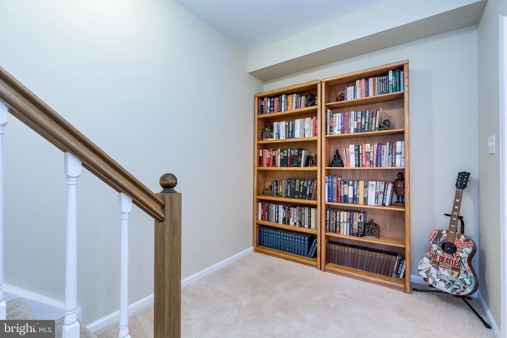 Lower Level w/ Wood Railing Below Staircase - 13309 FOXHOLE DR, FAIRFAX