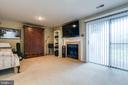 Recreation Room w/ Wood Fireplace & Walkout Door - 13309 FOXHOLE DR, FAIRFAX