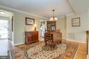 Dining Room w/ Laminate Flooring & Crown Molding - 13309 FOXHOLE DR, FAIRFAX