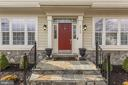 Slate Entry Porch will all new exterior lighting - 44136 RIVERPOINT DR, LEESBURG