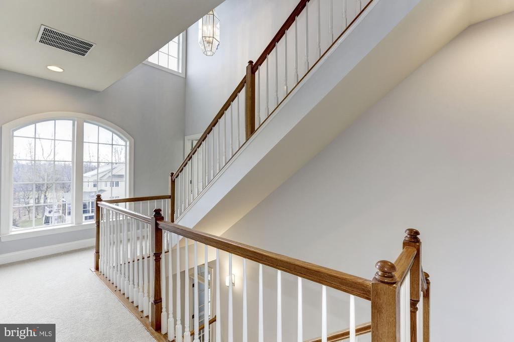 Upper Level Hallway with Staircase to Loft - 44136 RIVERPOINT DR, LEESBURG