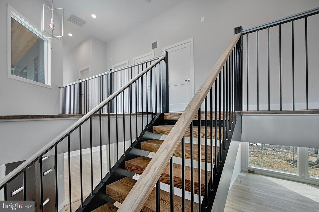 Walk up the staircase to upper level. - 6027 TULIP POPLAR CT, MANASSAS