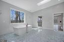 Master bath,  soaking tub, door to deck. - 6027 TULIP POPLAR CT, MANASSAS