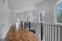 Down the hall, view  open rails toward master. - 6027 TULIP POPLAR CT, MANASSAS