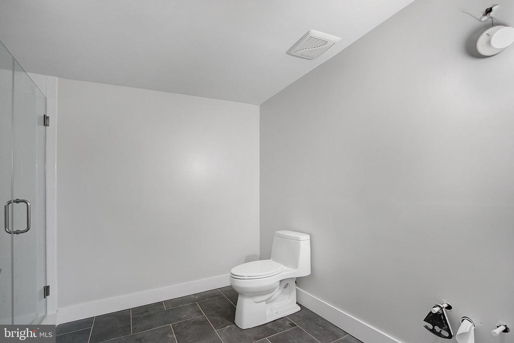 Lower level  full bathroom- perfect changing rm. - 6027 TULIP POPLAR CT, MANASSAS