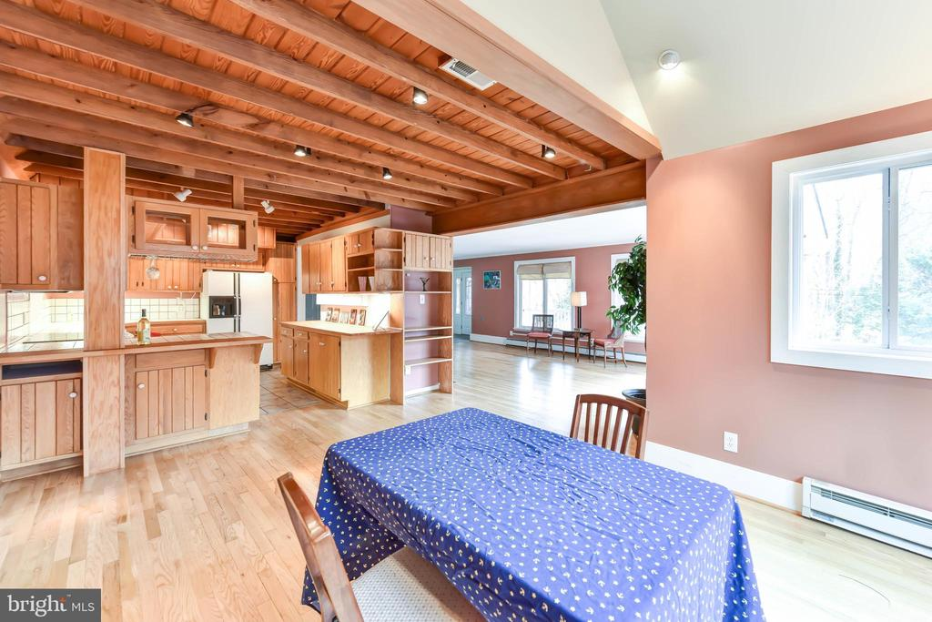 Natural wood ceilings warm this space - 4104 DUNCAN DR, ANNANDALE
