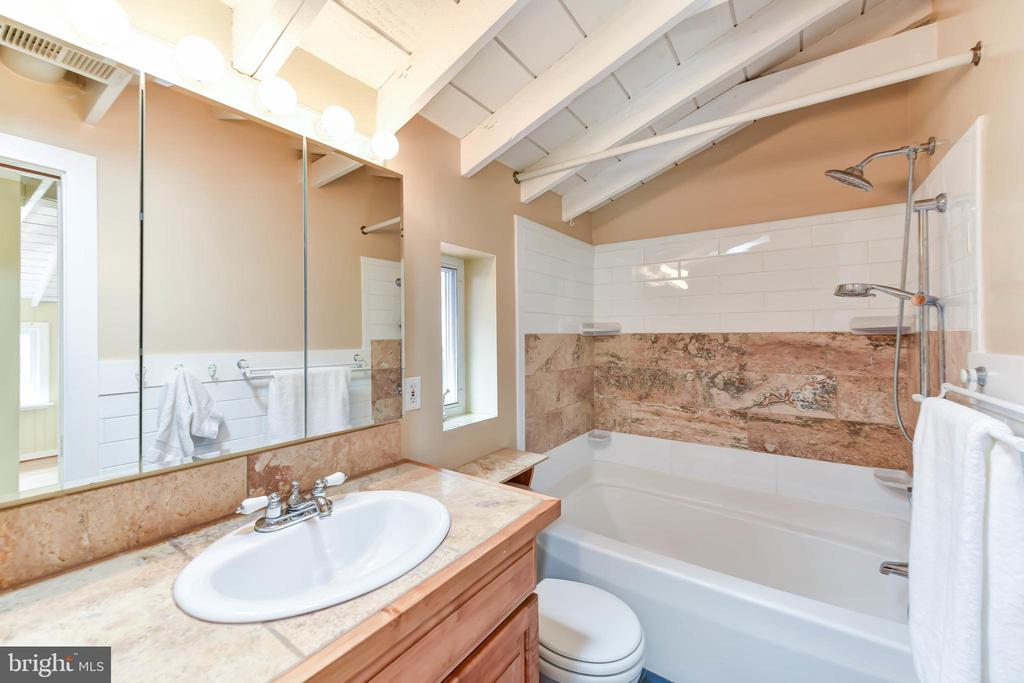 Master bath updated with  travertine tile - 4104 DUNCAN DR, ANNANDALE