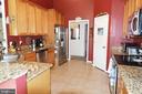 Main level kitchen - granite and stainless app - 9416 EVERETTE CT, SPOTSYLVANIA
