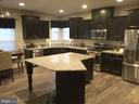 Kitchen and breakfast with stainless appliances - 10283 SPRING IRIS DR, BRISTOW