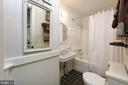A full bath located in the hall between BR 2 & 3 - 317 S SAINT ASAPH ST, ALEXANDRIA