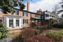 The garden features azaleas, hydrangeas & magnolia - 317 S SAINT ASAPH ST, ALEXANDRIA