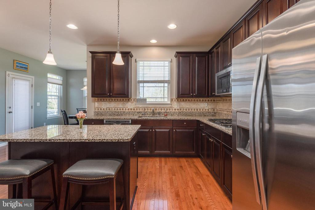 View of island and stainless steel appliances - 181 MILL RACE RD, STAFFORD