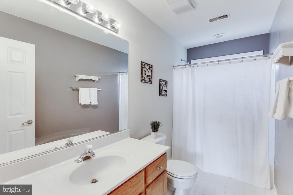 A total of three full bathrooms on upper level - 4112 FERRY LANDING RD, ALEXANDRIA