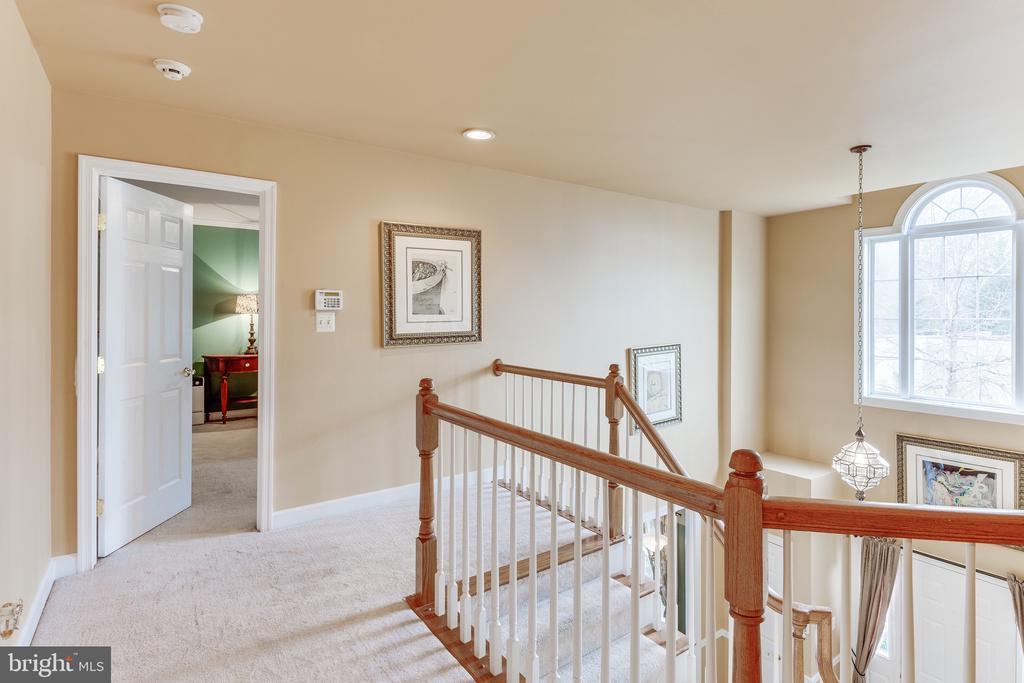 Upstairs hallway door open to master bedroom - 4112 FERRY LANDING RD, ALEXANDRIA