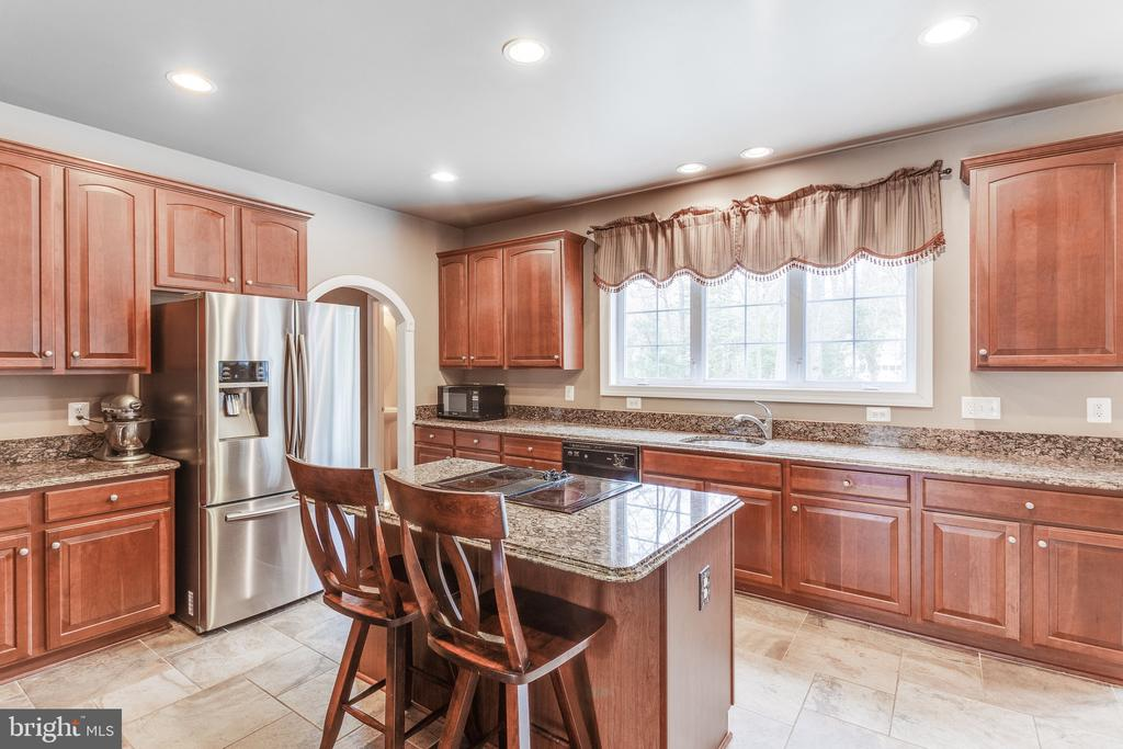 Natural light in kitchen with cherry cabinetry - 4112 FERRY LANDING RD, ALEXANDRIA