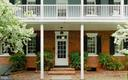 A welcoming front door with covered porch - 317 S SAINT ASAPH ST, ALEXANDRIA