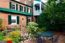 Views of the private garden in full bloom - 317 S SAINT ASAPH ST, ALEXANDRIA