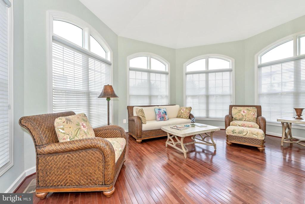 Peaceful sunroom filled with natural light. - 6902 SOUTHRIDGE PL, MIDDLETOWN
