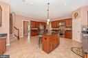 Gourmet kitchen with six burner stove. - 6902 SOUTHRIDGE PL, MIDDLETOWN