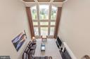 Upper view of two story family room. - 6902 SOUTHRIDGE PL, MIDDLETOWN