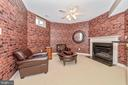 Sitting area with fireplace. - 6902 SOUTHRIDGE PL, MIDDLETOWN