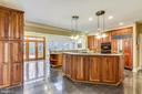 Wall to wall cabinets on far wall - 6620 HORSESHOE TRL, CLIFTON