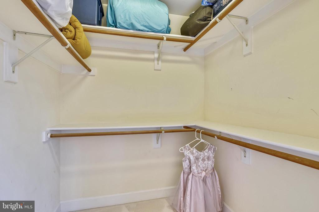 Walk-in closet of back  bedroom. - 6620 HORSESHOE TRL, CLIFTON