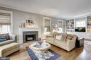 Living Room with Fireplace + Family Room - 3906 INGOMAR ST NW, WASHINGTON