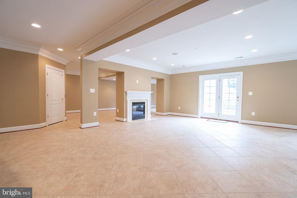 Lower level rec room with 2-sided fireplace - 9637 MAYMONT DR, VIENNA
