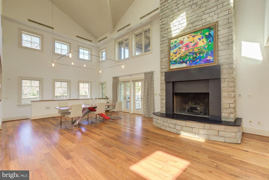 Great Room with Stone Fireplace rising 3 levels! - 1168 CHAIN BRIDGE RD, MCLEAN