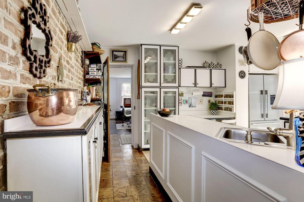 Kitchen with exposed brick wall - 221 N ST ASAPH ST, ALEXANDRIA