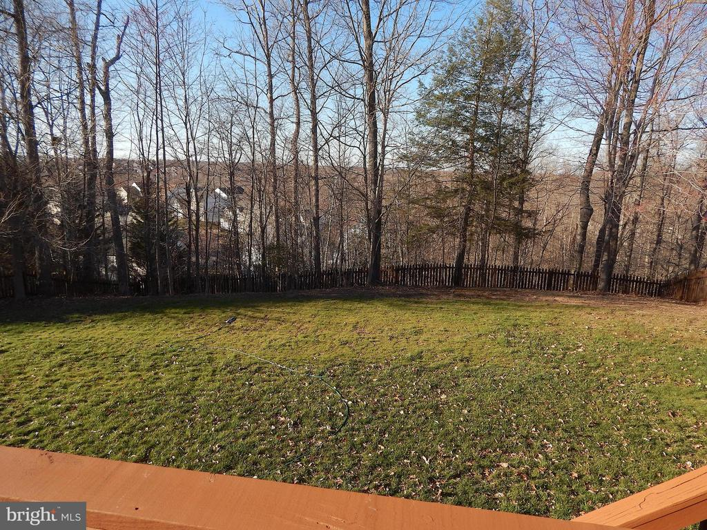 View of fenced back yard, from edge of deck - 81 BRUSH EVERARD CT, STAFFORD
