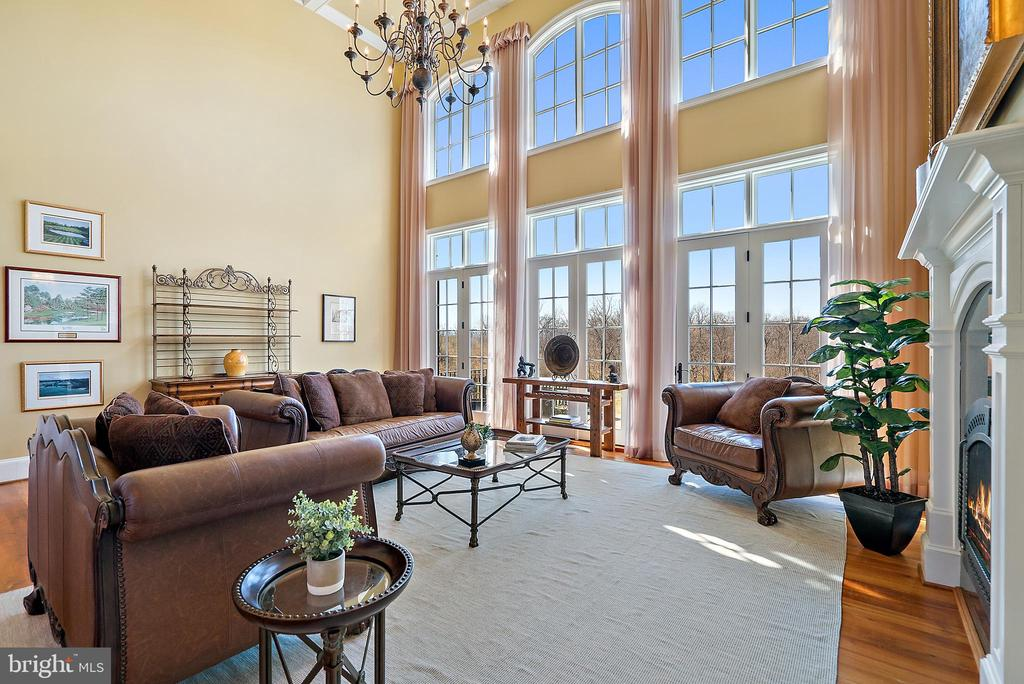 The grand Living Room boasts views for miles - 21051 ST LOUIS RD, MIDDLEBURG