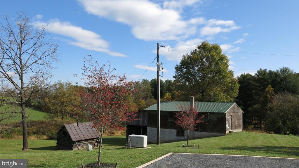 View of barn/garage and old log cabin - 761 FODDERSTACK RD, FLINT HILL