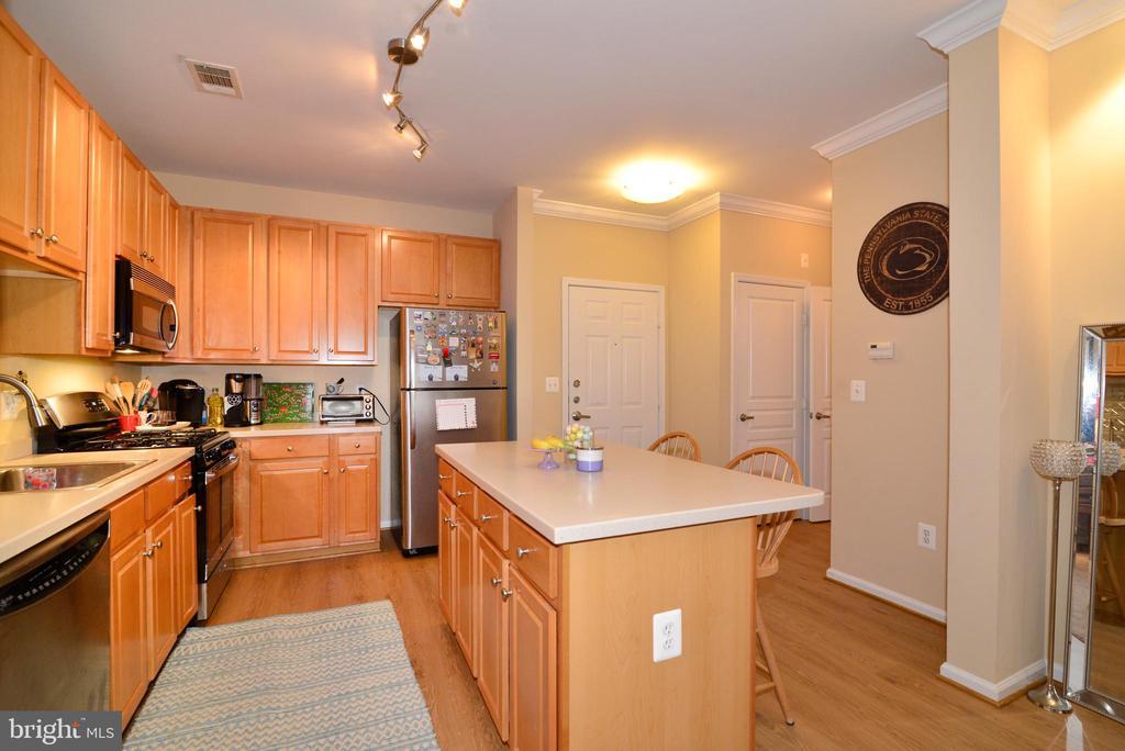 Kitchen and foyer - 12001 MARKET ST #214, RESTON