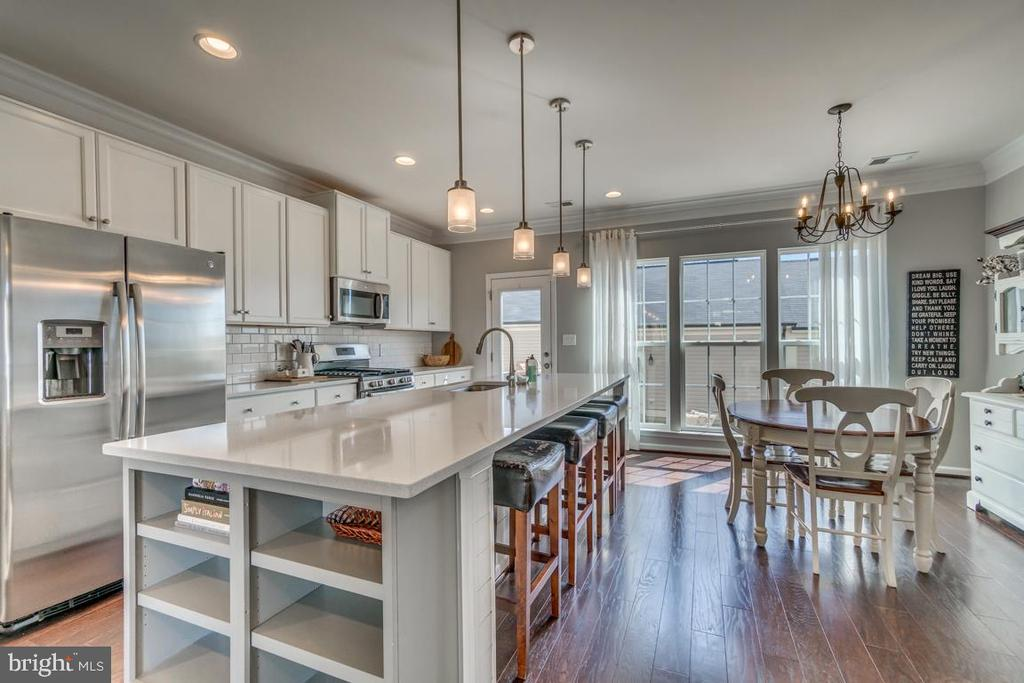 Kitchen opens to Eating Area - 861 BASSWOOD DR, STAFFORD